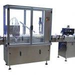 Automatisk flaskepåfyldning af låg og etiketteringsmaskine